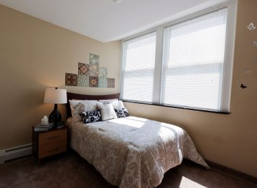 Amenities include bed, dresser, mirror, night stand